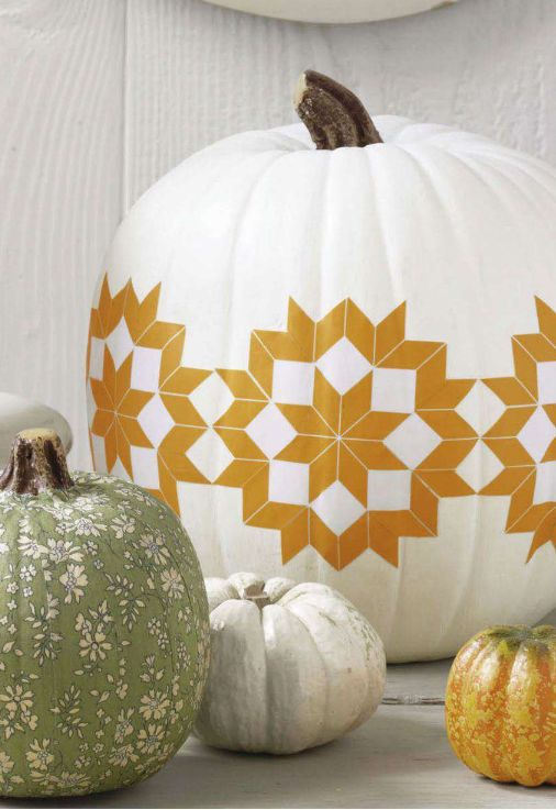 Tribal white and gold paint decorated pumpkin