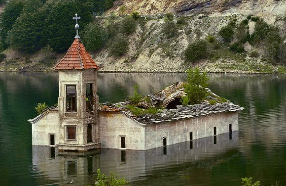 The church of St. Nicholas in Mavrovo, Macedonia was built in 1850 and stood for a 153 years until it was decided an artificial lake was needed in the village. At one point the church was fully submerged, but it keeps rising again, especially in summer with the droughts of the 21st century.