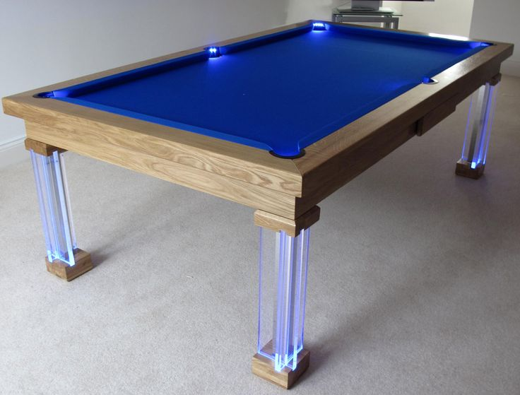 Here's a 7' Modern Pool Table in our Natural Oak (#0) finish. This table has a Hainsworth Smart Royal Blue and comes with our LED leg and pocket option.  More information can be found on our website.