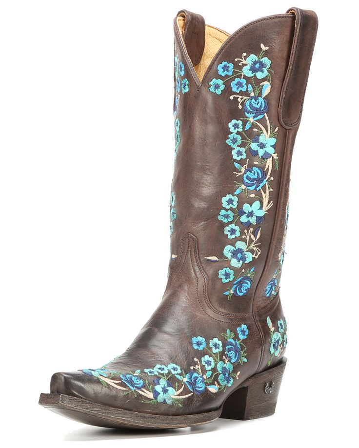 """""""Eight Second Angel's western boots have the nitty-gritty style country girls dream of. They're cute cowgirl boots that aren't afraid to have fun while keeping their eyes on the prize. Every Eight Second Angel cowgirl boot is handcrafted by skilled bootmakers. The Camellia Cowgirl Boots are no exception! With the colorful embroidered flowers, these boots are one of a kind and will look great paired with your favorite dress or jeans. Lively colors and beautiful embroidery enhance the…"""