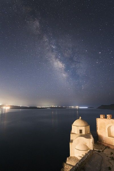 The Milky Way from Oia looking over Fira and the caldera in Santorini - Greek Islands Workshop - Ollie Taylor Photography