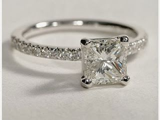 Engagement Ring!!!!!<3 Not too big, but big enough. Love the band size and diamond placement. Love square as the main stone shape.(: