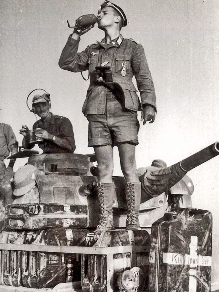 Afrika Korps soldiers with a Panzer 3