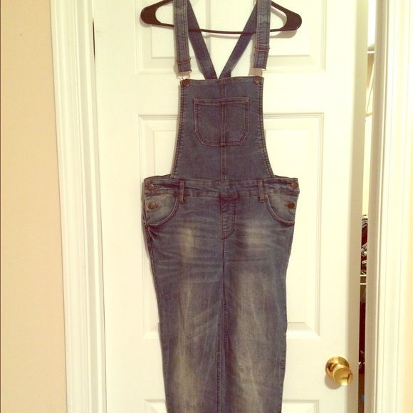 A blue jean jumpsuit Pre loved Blue skinny leg jumpsuit with the white faded look on the legs of the jumpsuit Cherokee Pants Jumpsuits & Rompers