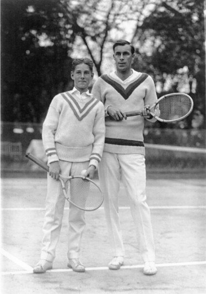 1920  Big Bill Tilden ushers in the golden age of tennis sporting a preppy array of cable knits and V-neck sweaters.