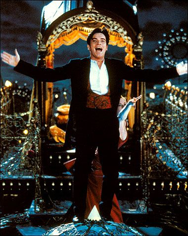 Christian (Ewan McGregor) singing on top of the elephant in Moulin Rouge!