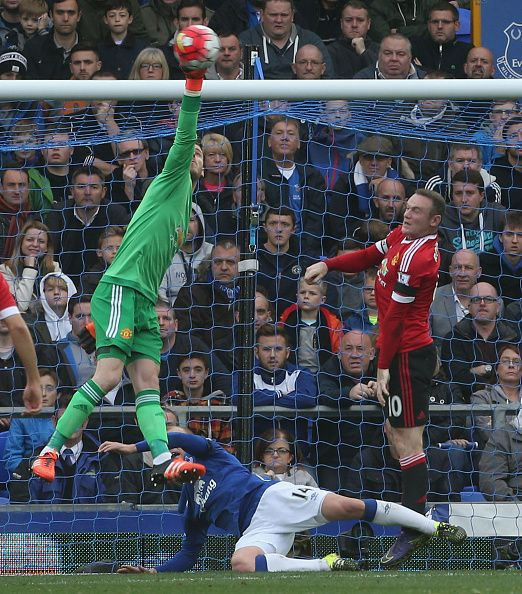 David de Gea of Manchester United makes a save during the Barclays Premier League match between Everton and Manchester United at Goodison Park on...