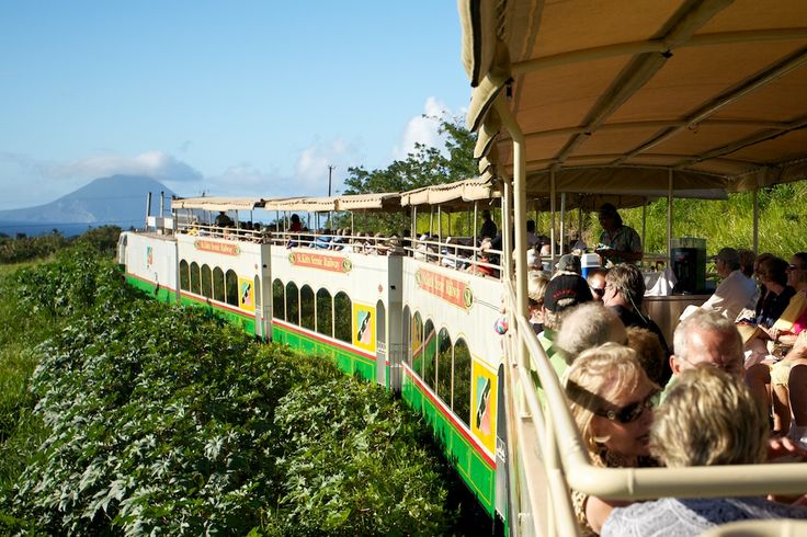 "St. Kitts Scenic Railway - ""3-hour tour that makes a 30-mile circle around the beautiful Eastern Caribbean island of St. Kitts, with 18 miles by narrow gauge train and 12 miles on sightseeing buses."""