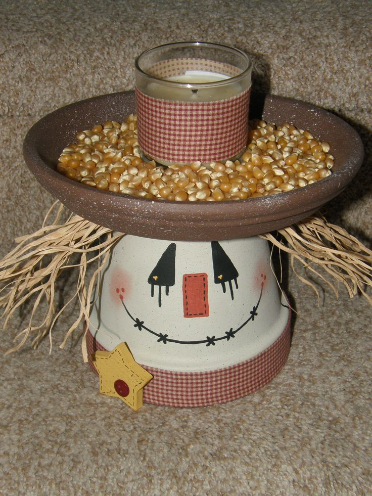 """Scarecrow... I made this cute Fall fella using a 6"""" terra cotta pot topped with an 8"""" saucer. Some raffia for hair, homespun fabric and a wooden star add to his charm. Thought he'd make a cute candy dish or candle holder ;) ~LVB"""