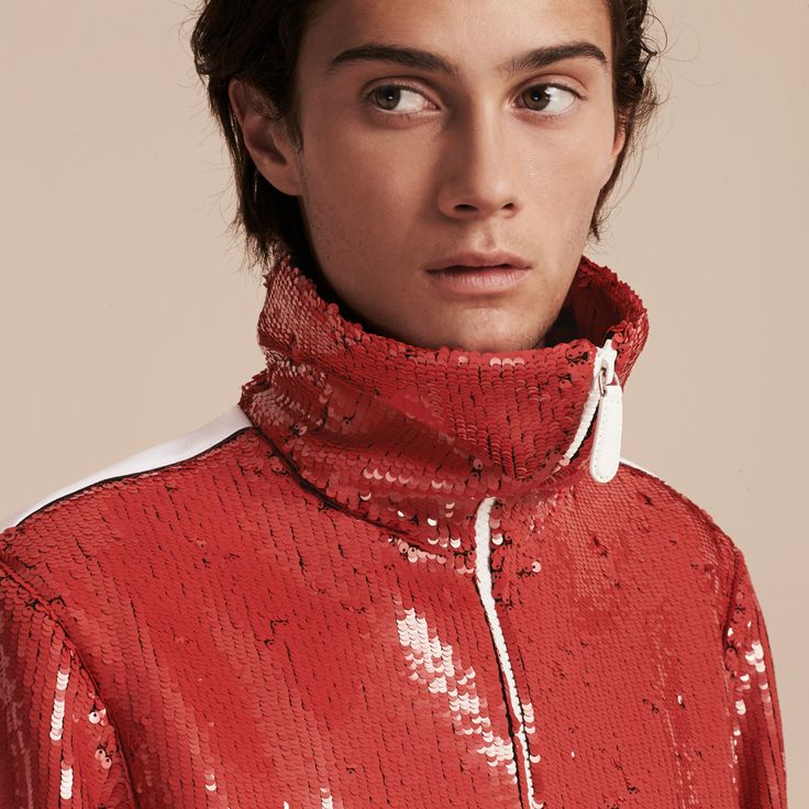 A zip-front track jacket knitted in a stretch technical fabric covered in light-catching sequins. Sport-inspired stripes detail the arms. Pair with jeans and wear with the funnel neck up under a trench coat on cooler days.