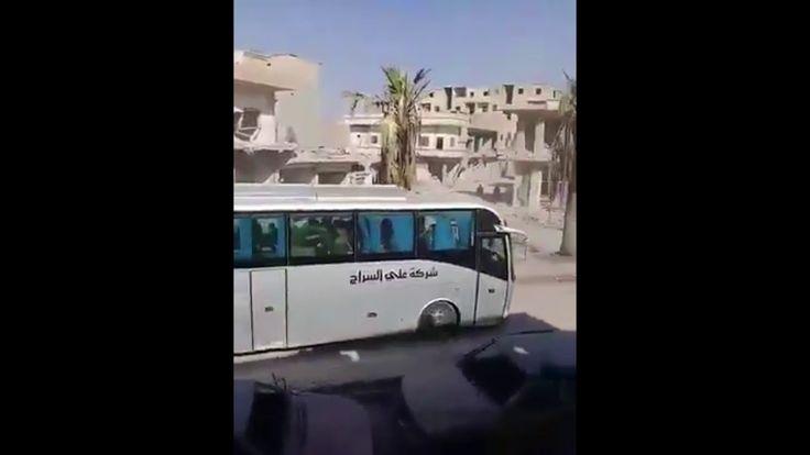 Колонна грузовиков и автобусов с боевиками