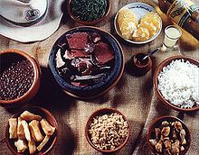 Feijoada, a dish made with black beas, pork, rice, collard greens, cassava flour and oranges. A must have when in Brazil.