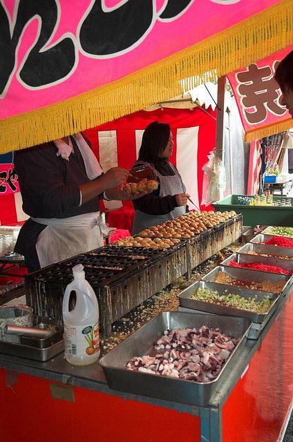 Japanese festival food. TAKO-YAKI (octopus   cooked in a batter shaped in balls...v)