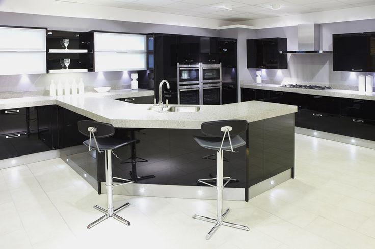 Open plan modern kitchen with large wraparound island