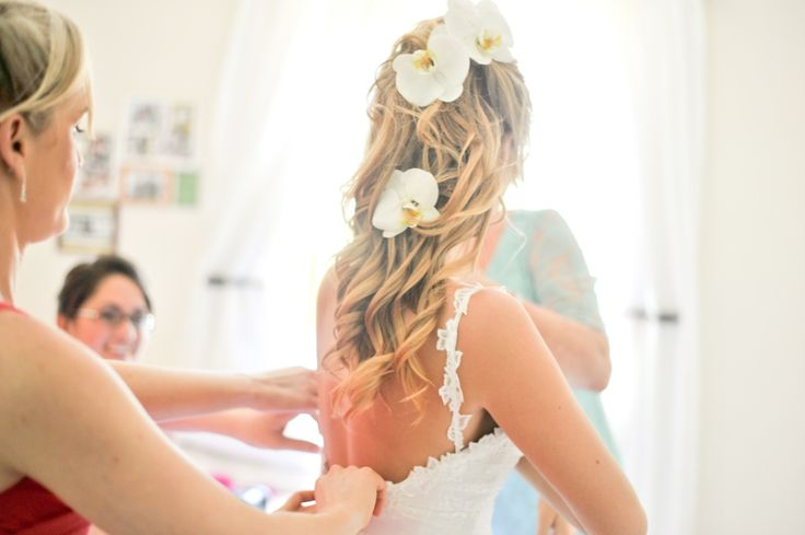 Bridal hair with orchid flowers, beachy feel