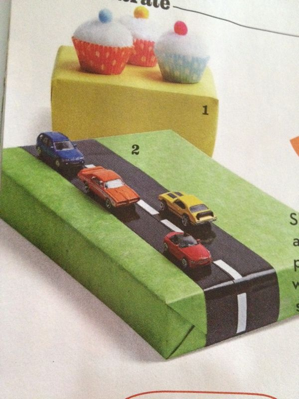 What a fun way to wrap a little boys gift - use a black marker and white tape to make the road and secure dollar store cars on top