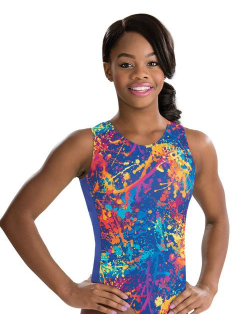 Sporty Gabby Douglas racerback leotard in bright sapphire nylon/spandex features a splat nylon/spandex print with foil insert that wraps around to the back. Includes matching scrunchie.