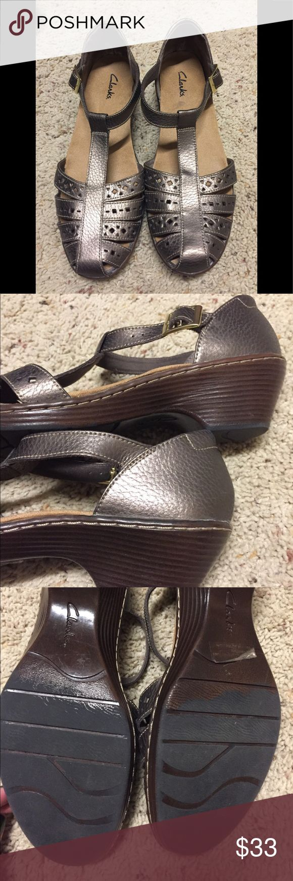 Clarks metallic pewter sandal Like new pewter metallic shoe. Closed toe, small wedgish heel and ankle strap. Clarks Shoes Sandals