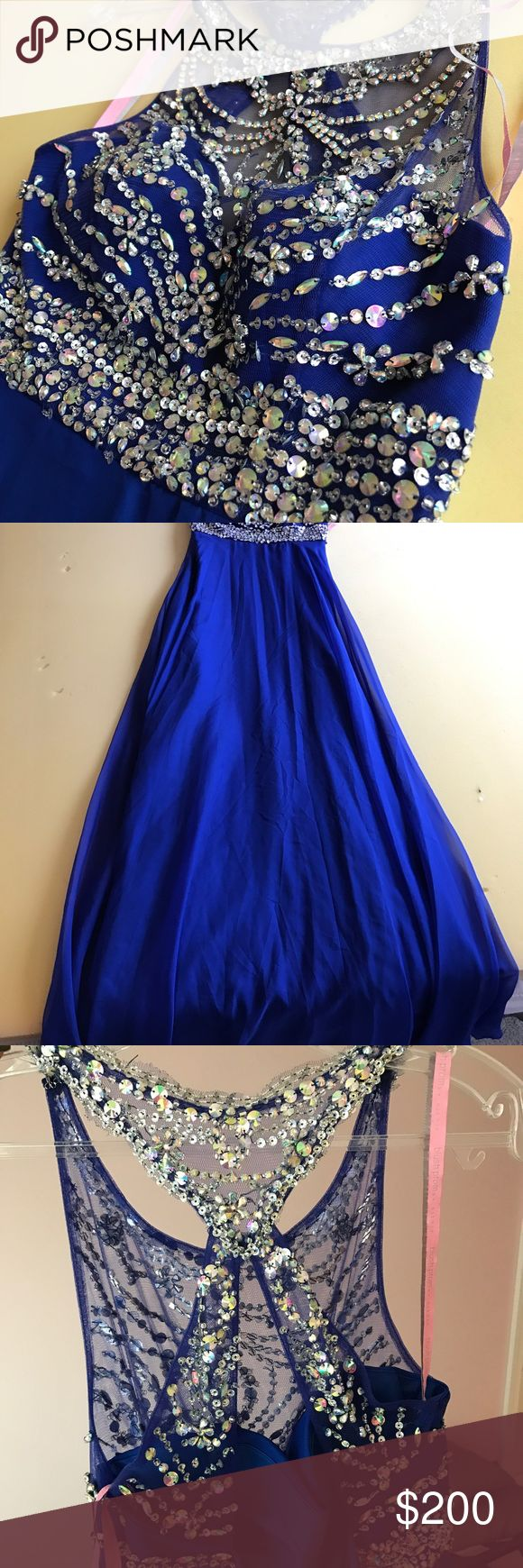 Royal Blue Prom Dress Royal blue and gorgeously beaded prom gown. Iridescent gems with a racer/open back. Empire waistline with a long flowing skirt. No damage and NEVER worn. ❤️ Blush Dresses Prom