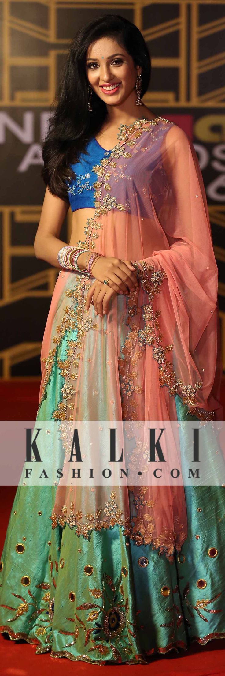 A perfect blend of green, blue and pink which look royal and stands out as she walks down the ramp