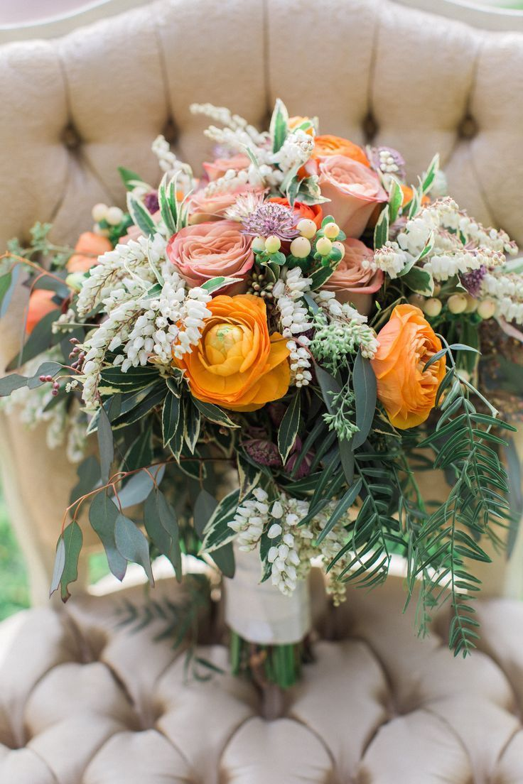 Orange and ivory flowers make a lovely fall wedding bouquet.   Pretty Vintage Rentals - California weddings