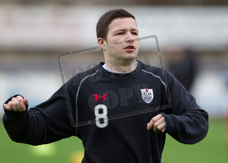 Queen's Park's Conor McVey wars up before the SPFL League Two game between Montrose and Queen's Park.
