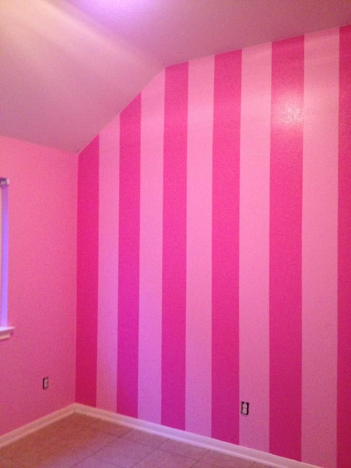 Pink striped wall. I painted this in the nursery!!