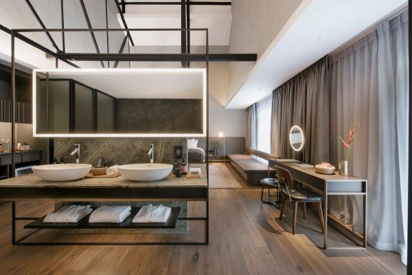 The Warehouse Hotel - interior room: This 37 room boutique hotel is the result of the conversion of three XIX century warehouses, which are an important part of Singapore\'s trading history. One of the carefully restored facades of the hotel faces the Singapore River; the colo...