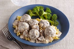 KRAFT Creamy Beef Stroganoff Meatballs 1 Tbsp. oil1 lb.(450 g) fresh mushrooms, quartered1 onion, chopped2 cloves garlic, minced1 cup Philadelphia Herb & Garlic Light Cream Cheese Product1 cup 25%-less-sodium beef broth1 Tbsp. Dijon mustard1/2 tsp. dried thyme leaves1/4 tsp. paprika1 recipe Basic Meatballs8 cupshot cooked egg noodles