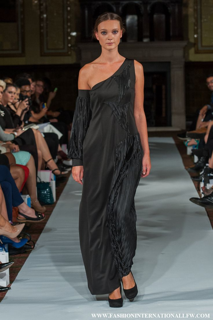 Lenie Boya S/S 2015 London Fashion Week. Black futuristic, asymmetric dress with pleated details and bishop sleeve arm detail.