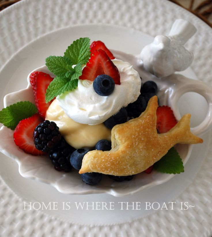 An easy dessert! Use a cookie cutter to cut a bird shape out of puff pastry, brush with egg wash and sprinkle with sanding sugar and bake. Serve with lemon curd, berries and whipped cream | homeiswheretheboatis.net