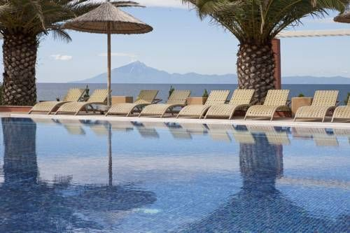 Alexandra Beach Spa Resort Potos Surrounded by a lush garden with roses and palm trees, the seafront hotel Alexandra Beach Spa Resort is within walking distance from the picturesque villages of Potos and Pefkari in Thasos Island.
