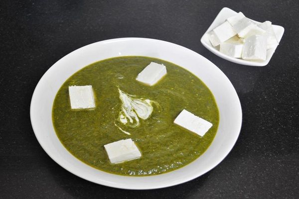 Simple Cheesy Spinach Cheesy Spinach recipe is a famous North-Indian cuisine prepared with  soft paneer and blanched spinach. Where paneer cubes are mixed with healthy spinach gravy,  sauteed with unique onion paste. Check out details here:http://goo.gl/r6nLAT