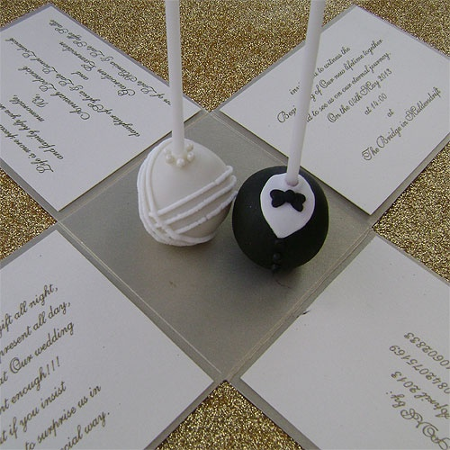 Ref Cake boss gold with cake pops ( we can do any colour) www.weddingcards.co.za