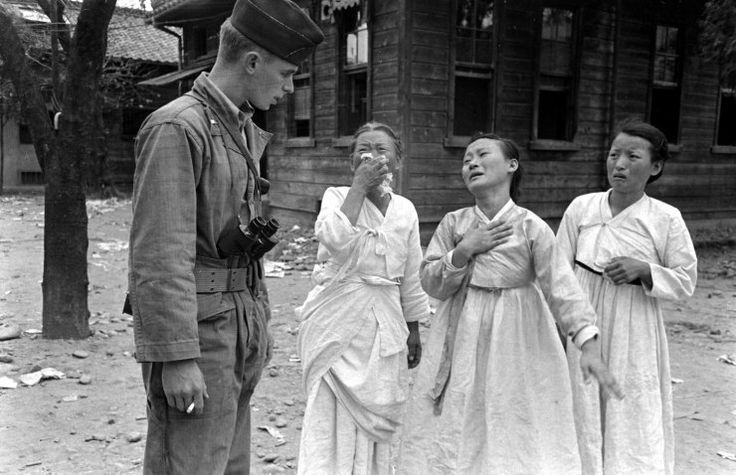 Grieving women and an international observer during the 1948 Yeosu-Suncheon rebellion against the Rhee government. Carl Mydans, Time/Life. Not published.