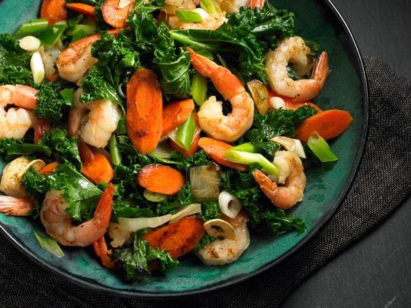 Garlic Shrimp and Kale Stir-Fry: sesame oil, shrimp, onion, garlic, scallions, carrots, chopped kale, chicken broth and hoisin sauce