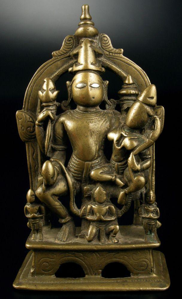 North Karnataka or Maharashtra bronze Vishnu with Lakshmi mounted on Garuda. Two devotees/ attendants flank the main deities. Circa 17th century.