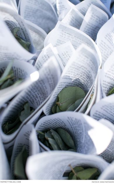 Confetti idea with pages from old books and green leaves   Photographer: Adene Photography