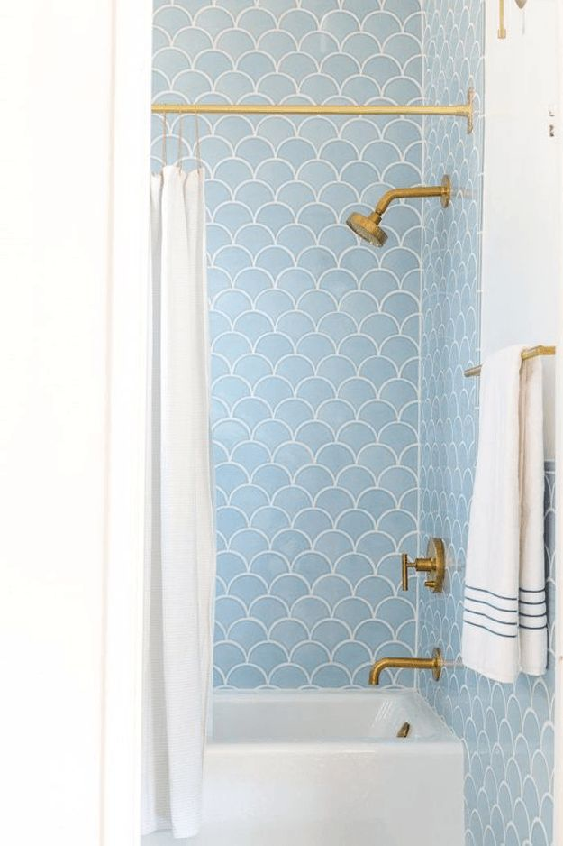 retro shower with powder blue scallop tile, pantone airy blue, sky blue, light blue, vintage style bathroom, gold fixtures, white accents