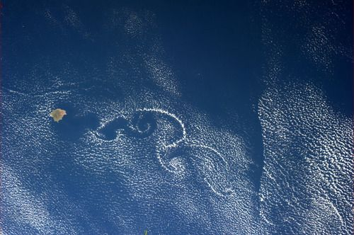 colchrishadfield:  A island off the Pacific coast of Mexico spins clouds into swirls of lace.