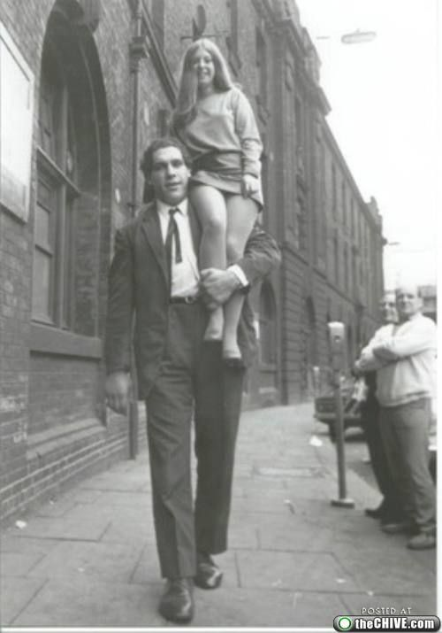 A young Andre the Giant. I wish I had an Andre to carry me around like this.