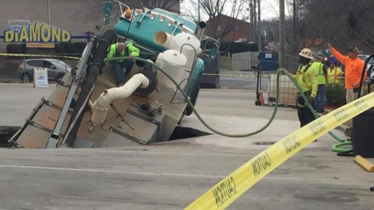 An 18-wheel truck weighing approximately 55,000 pounds collapsed into a sinkhole Tuesday morning in Hall County, Ga. The Badger Hydrovac truck was carrying 1,600 gallons of water, which along with …