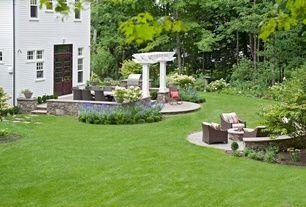 Craftsman Landscape/Yard with Bird bath, exterior tile floors, Restoration Hardware LA JOLLA LOUNGE CHAIR, Fire pit