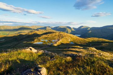 The mountain summit of Place Fell in the Lake District at sunset.