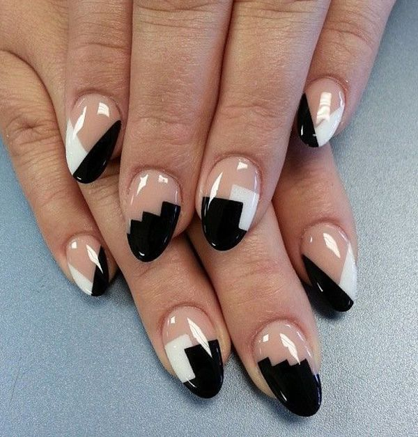 Black and white oval tip abstract nail art design. The clear polish base coat helps make the design even more noticeable and unique.