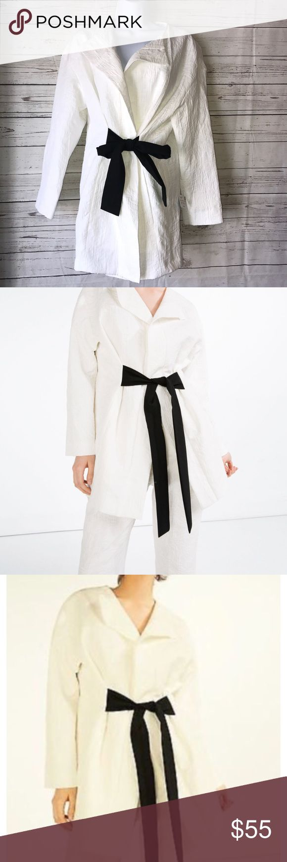 Zara white long jaquered blazer jacket Sz Small New with Tags Blazer by Zara. Super cute for fall in winter. It mainly white with a contrasting black sash tie belt.  Outer shell: 69% cotton, 31% polyester. Lining. 100% Acetate Zara Jackets & Coats Blazers