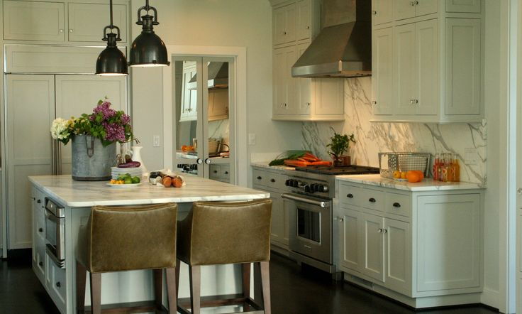 Benjamin Moore colors Horizon, Grey Owl, and Sea Haze play off of the various warm grey tones in the Calcutta marble.