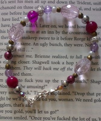 'Celeste' bracelet, with pink agate beads, purple beads and light pink large beads. Hand-made jewellery.