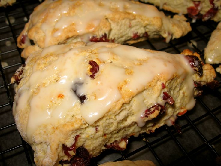 Cranberry Orange Scones 2 cups All-purpose Flour 10 teaspoons Granulated Sugar, Divided 2 teaspoons Baking Powder ½ teaspoons Salt ⅓ teaspoons Baking Soda 1 Tablespoon Grated Orange Peel ⅓ cups Cold Butter Or Margarine 1 cup Dried Cranberries ¼ cups Orange Juice ¼ cups Half-and-Half Cream 1 whole Egg 1 Tablespoon Milk _____ FOR THE GLAZE: ½ cups Powdered Sugar 1 Tablespoon Orange Juice