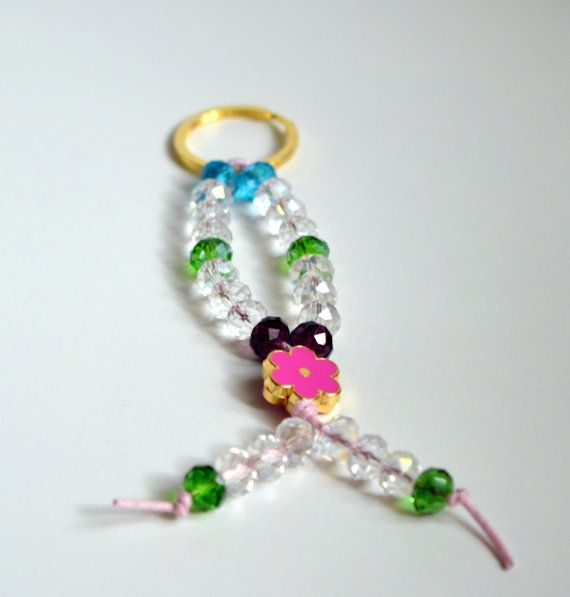 An impressive 2015 Good Luck #Key Chain to put your  home or #car keys.. It is made from Swarovsky crystal  beads.  From a metal gold  ring ,hanged a pink waxed cord   from ... #keychain #brelock #keys #house #key #holder #holidays #christmas #ornament #decoration #glossy #beaded #gemstones #enameled